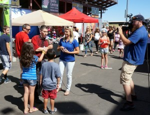 More promo with KBOI TV on the midway at the Fair