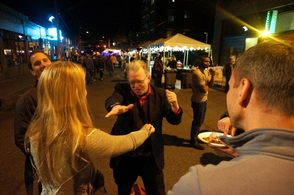 Magician Rick Anderson performs close-up magic for the SCAA attendees in downtown Seattle