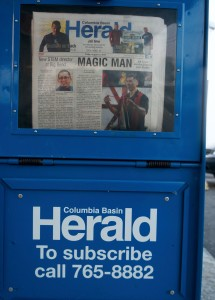 Magician Jeff Evans is featured on the front cover of the Columbia Basin Herald