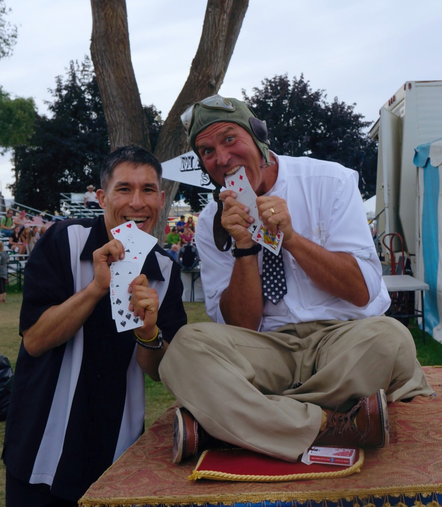 Magicians Jeff Evans and Steve Hamilton performing strolling magic for the Spokane Interstate Fair