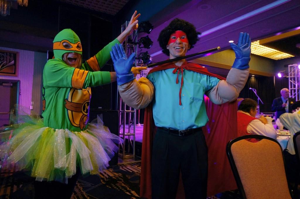 Teenage Mutant Ninja Turtle (Island County Fair manager Carol) captures Super Hair-O (Jeff Evans)