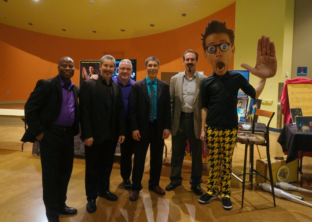 College magician Jeff Evans and performers gathering for a quick photo at South Puget Sound Community College