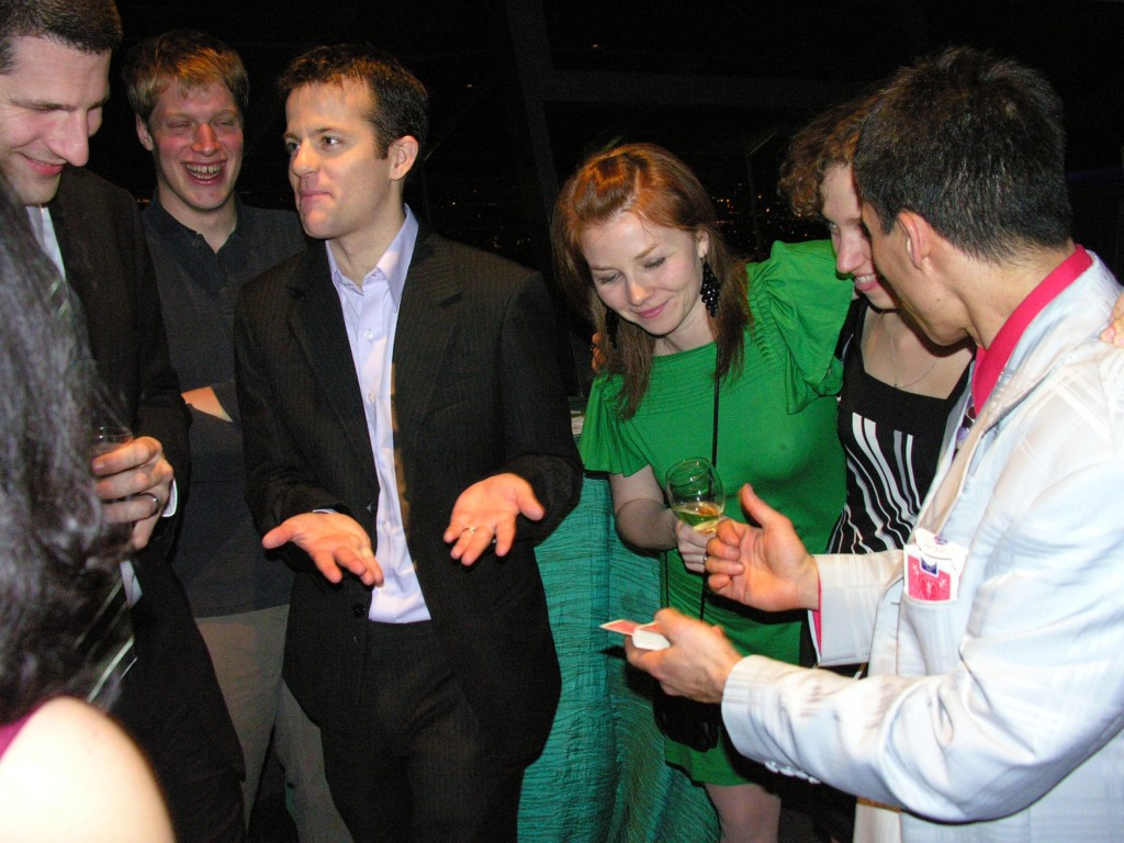 Corporate event magician Jeff Evans amazes guests at a Microsoft company party at the Seattle Space Needle