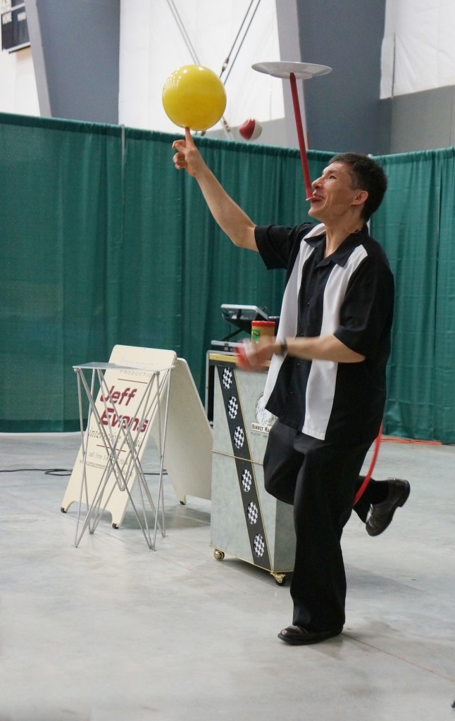 Multitasking:  spinning a plate on a mouthstick, juggling two balls in one hand, spinning a ball on my other finger, while spinning a ring on one leg