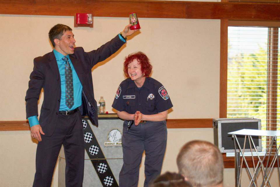 Magician Jeff Evans and volunteer firefighter Cat at the City of Snoqualmie Volunteer Appreciation Dinner.  Photo by Jeff Goble.