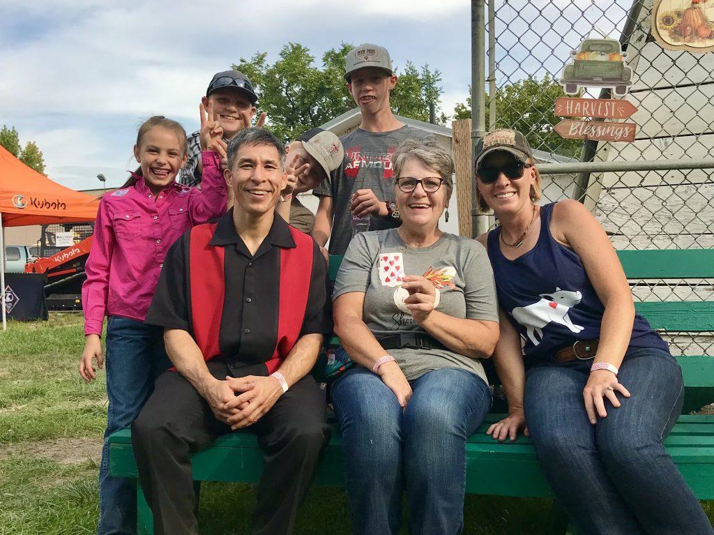 Magician Jeff Evans and fans at the 2021 Okanogan County Fair in Omak, Washington
